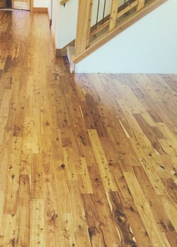 Picture - unfinished Australian Cypress flooring, after installation and finishing.